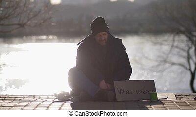 Homeless war veteran male begging on the street - Homeless...