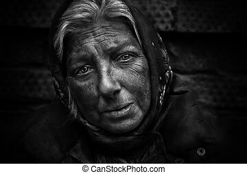 Homeless woman - close up of old woman, she live on the ...