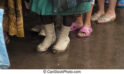 Homeless woman in torn boots - Homeless woman in old shoes...