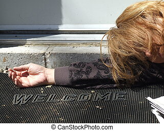 Homeless woman passed out in a doorway