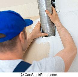 homem, configurando, sistema ventilação, indoors.
