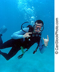 homem, equipamento mergulho mergulhando
