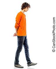 homem jovem, andar, triste, furo, vista lateral