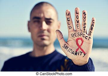 homem jovem, com, um, fita vermelha, para, a, luta, contra, ajudas, em, seu, mão