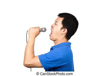 homem jovem, com, um, microfone, cantando