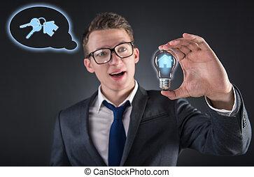 homem jovem, em, hipoteca, conceito, com, bulbo leve
