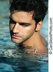 homem jovem, em, piscina