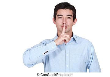 homem jovem, segura, dedo, antes de, lábios