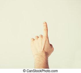 homem, mão apontando, em, algo