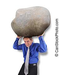 homem negócio, com, pesado, tensão, rocha