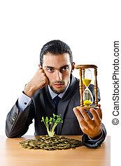homem negócios, com, ouro, seedlings, e, moedas