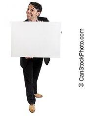 homem negócios, com, um, sorrr forçadamente cheesy, prendendo um sinal