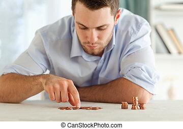 homem negócios, contagem, seu, pequeno, moedas