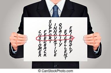 homem negócios, crossword, segurando, serviço, cartaz