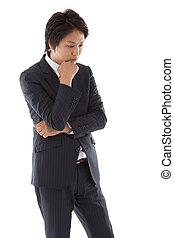 homem negócios, jovem, pensando
