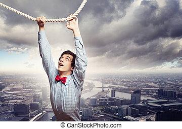 homem negócios, pendurar, corda