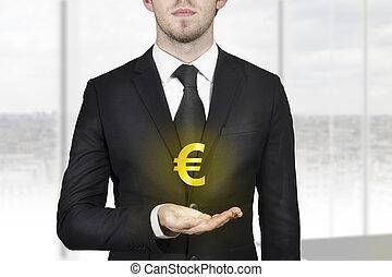 homem negócios, símbolo, dourado, segurando, euro