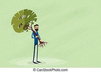 homem negócios, segurando, árvore verde, proteção ambiente