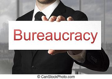homem negócios, sinal, segurando, burocracia