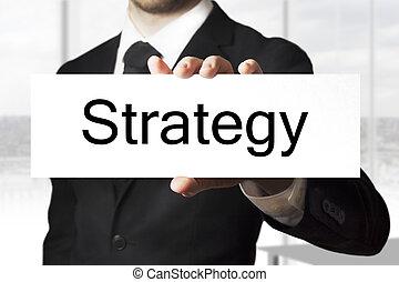 homem negócios, sinal, segurando, estratégia