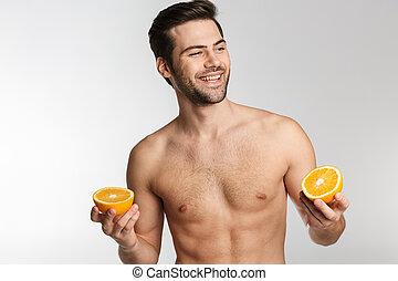 homem, rir, segurando, foto, laranja, metade-despido, alegre