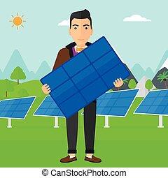 homem, solar, panel., segurando