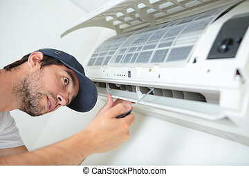 homem, trabalhar, ar condicionado, unidade