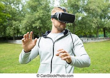 homem, usando, realidade virtual, headset, óculos