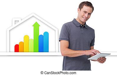 homem, usando, tabuleta, contra, energia, eficiente, casa, gráfico