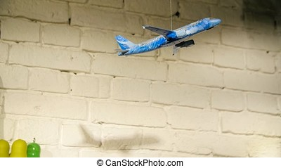 Homemade airplane in the room. On the background of stone...