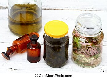 Homemade alternative medicine, Echinacea tincture and herbal oil, in front