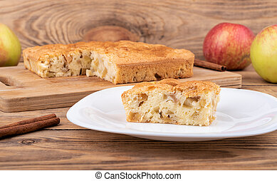 Homemade apple dessert with cinnamon charlotte on a cutting board.