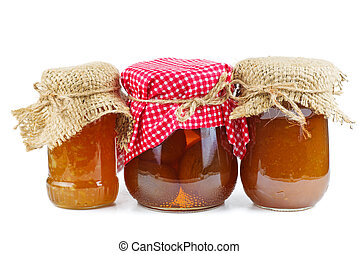 Homemade apricot, peach and lemon jam in glass jars isolated on white background