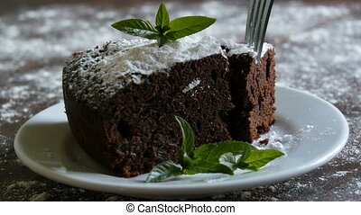 Homemade baked chocolate brownie cake muffled with powdered...