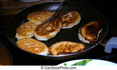 Homemade baking. Cooking fried fresh delicious pancakes in a pan in boiling oil.