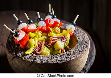 Homemade banderillas with peppers, olives and anchovies for spanish corrida