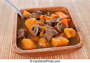 homemade beef stew - bowl of homemade beef stew with carrots...