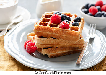Homemade belgian waffles with berries