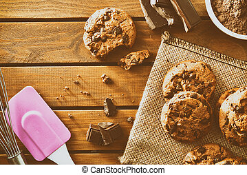 Homemade biscuits with chocolate on wooden slatted table top vintage