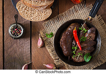 Homemade blood sausage with offal on the old wooden...