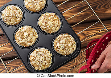 Homemade blueberry bran muffins with almond in bakeware