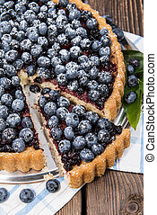 Homemade Blueberry Tart on vintage wooden background