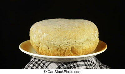 Homemade Bread on the Table Rotates on a Black Background