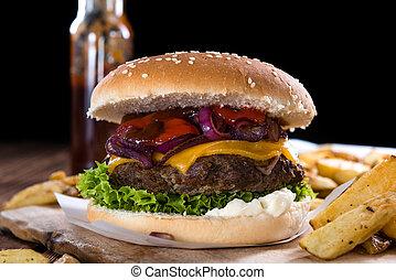 Homemade Burger - Big fresh made Burger on rustic wooden...