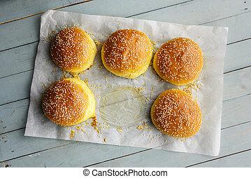 Homemade burger bun on parchment