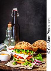 Homemade burger on a dark background