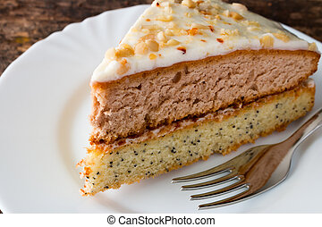 homemade cake on a white plate with a fork