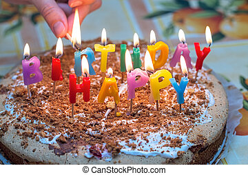 Cake with burning candles on birthday