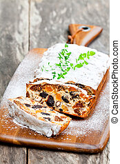 homemade cake with dried fruits on rustic wooden table