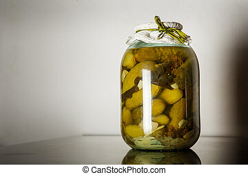 homemade canned cucumbers in glass jar
